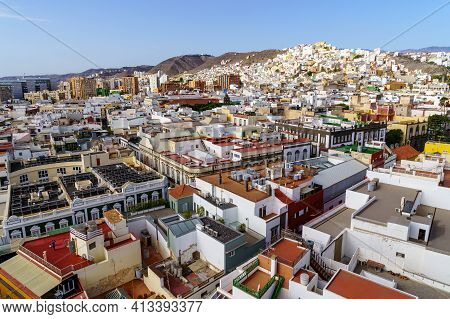 Aerial View Of The City Of Las Palmas, Small White And Brightly Colored Houses By The Sea With Blue