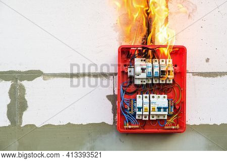 Burning Switchboard From Overload Or Short Circuit On Wall. Circuit Breakers On Fire From Overheatin