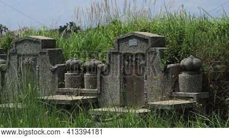 Chinese Culture Traditional Concrete Tombs With Chinese Memorial Name Is In The Graveyard. Pekalonga
