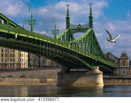 Hungary Budapest, Liberty Bridge Against The Backdrop Of A Dramatic Sky Reflected In The Water