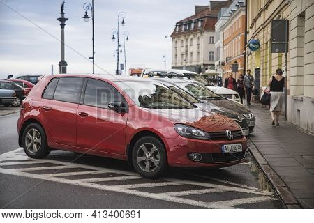Warsaw, Poland, August 2017: Volkswagen Golf In A Parking Lot In Rainy Warsaw