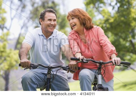 Mature Couples Bike Riding.
