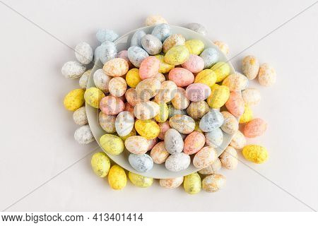 Mixed Chocolate Coated Easter Eggs Candies On A Small Plate Isolated On A White Table, Tasty Sugary