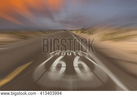 Historic Route 66 pavement sign with motion blury near Amboy in the California Mojave desert.