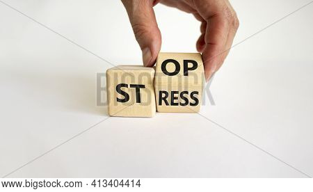Stop Stress And Be Health Symbol. Doctor Turns A Cube And Changes Words 'stress' To 'stop'. Beautifu