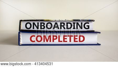 Onboarding Completed Symbol. Books With Words 'onboarding Completed'. Beautiful White Background. Bu
