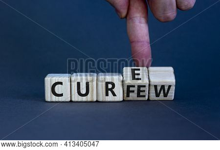 Curfew And Cure Symbol. Businessman Turns Cubes And Changes The Word 'curfew' To 'cure'. Beautiful G