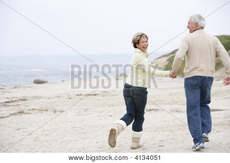 Couples At The Beach Holding Hands And Smiling