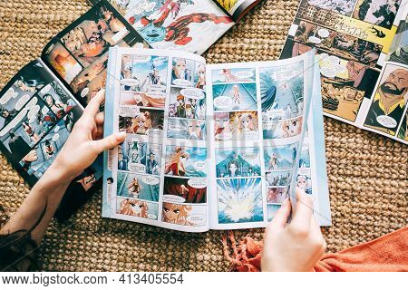 Woman Reads Manga Comic Book On The Carpet At Home. Rostov-on-don, Russia. 15 March 2021