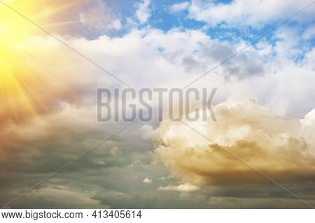 Beautiful Dramatic Clouds On The Blue Sky Background At Sunset. Warm And Cool Colors. Horizontal