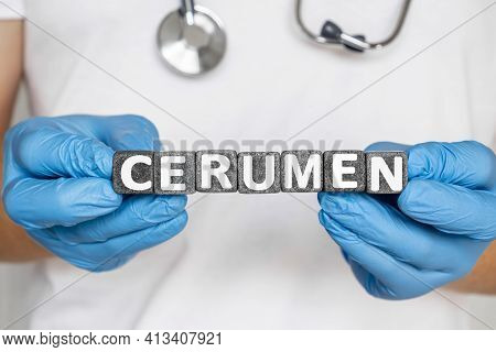 Cerumen - Word From Stone Blocks With Letters Holding By A Doctor's Hands In Medical Protective Glov