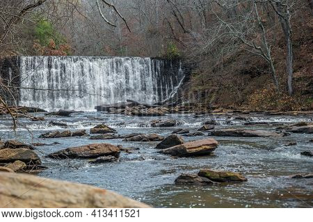 Standing Downstream On A Boulder Looking At The Waterfall Spilling Into The Creek Closeup At The Old