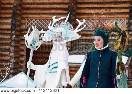 Actors At The Performance In The Role Of Winter And Summer. Safari Park