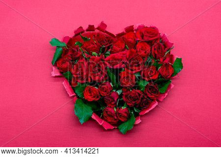 Decoration Heart Made Of Fresh Roses, Flat Lay, On A Pink Background. Template For Valentine's Day,