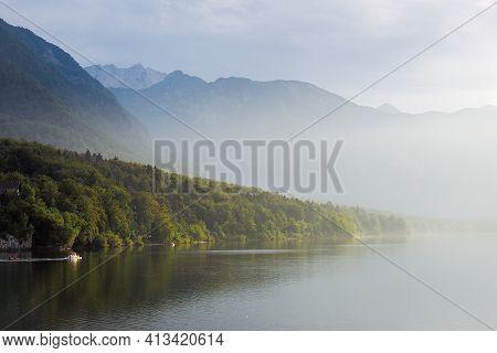 Morning Fog On Lake Bohinj, Slovenia. Defocused