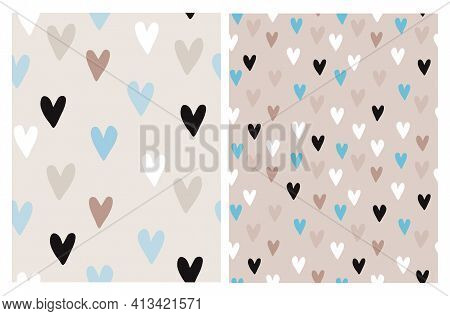 Cute Hand Drawn Irregular Romantic Vector Patterns With White, Black, Blue And Brown Hearts Isolated