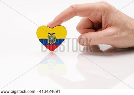 Ecuador Flag. Love And Respect Ecuador. A Man's Hand Holds A Heart In The Shape Of The Ecuador Flag