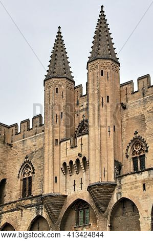 Stone Walls And Towers Of The Medieval Castle Of The Popes In The City Of Avignon In France