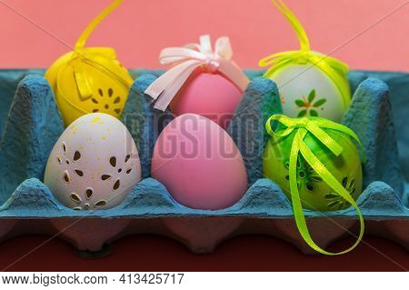 Easter Egg As Decoration. The Easter Egg Is In The Egg Carton. The Background Is Monochrome.