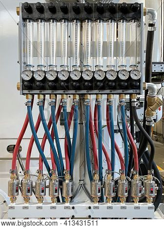Circuit With Blue And Red Hoses Connecting Graduated Test Tubes With Pressure Gauges And Temperature