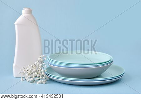 Dish Detergent On A Blue Background. Cleaning In The House, Apartment, Office. Plastic Packaging. Ho