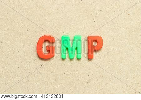 Color Alphabet Letter With Word Gmp (abbreviation Of Good Manufacturing Practice) On Wood Background