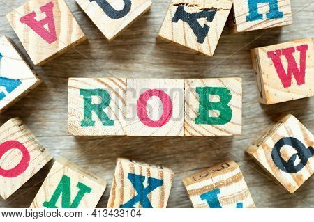 Alphabet Letter Block In Word Rob (abbreviation Of Rhythm Of Business) With Another On Wood Backgrou