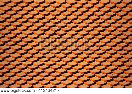 Texture Background. Clay Tile Roof Texture Of Temple With Shadow From Gable Apex