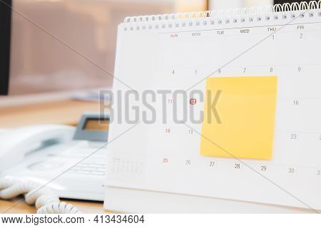 Close-up Desk Calendar And Office Note Paper Concept Of Event Planner Or Busy Or Planning For Busine