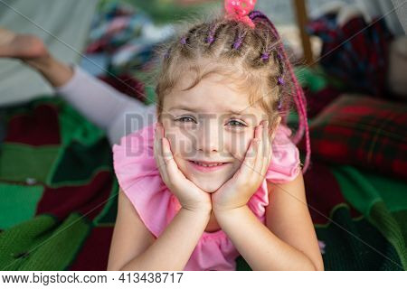 Smiling Girl In Tent. Kid Playing In Tent. Kids Camping. Having Fun Outdoors. Campground. Funny Face