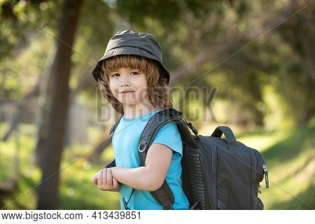 Little Boy With Backpack Hiking In Scenic Mountains. Boy Local Tourist Goes On A Local Hike.