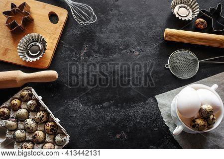 Groceries And Utensils For Baking On A Black Background With Place For Text
