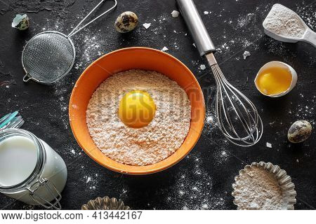 Ingredients And Utensils For Baking On Black Background