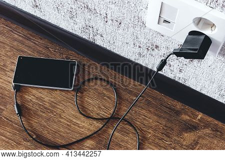 Phone Charging In The Apartment On The Floor