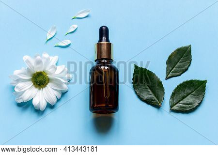 Perfume Bottle On A Blue Background Close Up