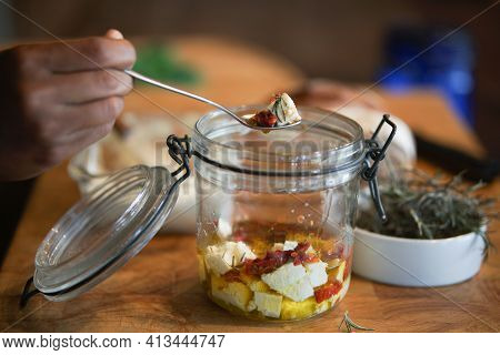 Cottage Farmer Paneer Cheese, Sun Dried Tomatoes And Rosemary Marinated In Olive Oil In Glass Jar.