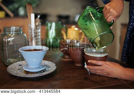 Barista Preparing Brewing Coffee With Coffee Maker And Drip Kettle.