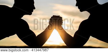 Two Men Arm Wrestling. Silhouette Of Hands That Compete In Strength. Rivalry, Vs, Challenge, Strengt