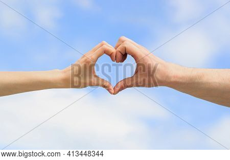 Hands In Shape Of Love Heart. Heart From Hands On A Sky Background. Love, Friendship Concept. Girl A