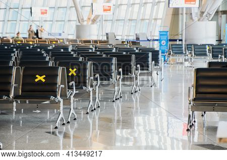 Moscow, Russia: 03.14.2021 - Vnukovo International Airport, Departure Area. Labeled Waiting Chairs F