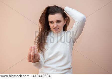 Girl Holds A Piece Of Hair In Her Hand. Brittle Hair.