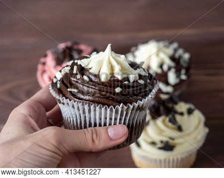 Delicious Fresh Cupcake With Dark And White Chocolate In Your Hand. Side View, Blurred Background, S