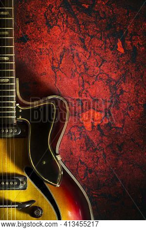 Old, Jazz Electric Guitar On A Red Grunge Background. Copy Space. Background For Music Festivals, Co
