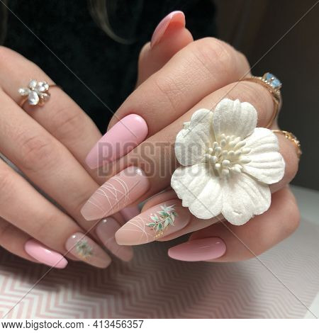 Women's Pink Manicure With Design.hands Of A Woman With Pink Manicure On Nails