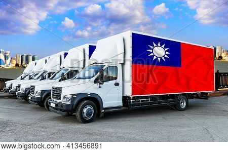 Taiwan Flag On The Back Of Five New White Trucks Against The Backdrop Of The River And The City. Tru