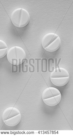 Black And White Vertical Background On The Theme Of Medicine, Health Care, Pills, Pharmacology. Ligh