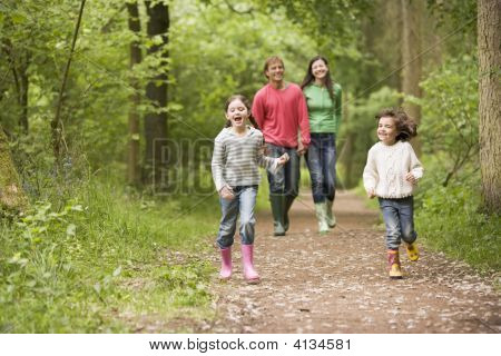 Families Walking On Path Holding Hands Smiling
