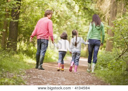 Families Walking On Path Holding Hands