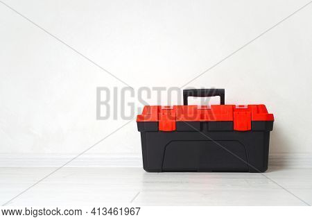 The Toolbox Or Toolkit Box Is On The Wooden Floor. Background With Copy Space.