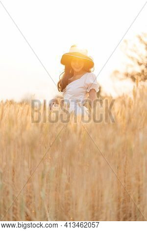 Happy Young Beautiful Woman Wearing Black Hat And White Dress Enjoying Herself Walking In The Golden